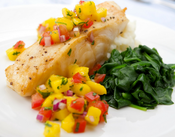 Fish and mango salsa with vegetables